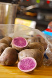 Blue Potatoes in Kitchen Royalty Free Stock Images