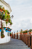 Blue Pots of Mijas in an alleyway, Andalucia, near Malaga, Spain Royalty Free Stock Image