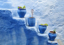 Blue pots at the stairs Royalty Free Stock Photos