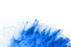 Blue powder explosion on white background. royalty free stock photo