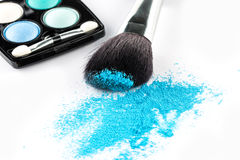 Blue Powder Eyeshadow on a Brush with Make up Palette Royalty Free Stock Photos