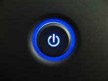 Blue power button. A glowing blue power Button royalty free stock images