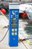Blue power supply case stands on floating pier Stock Image