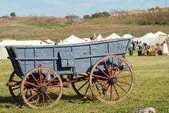 A blue prairie wagon at a reenactment Stock Images