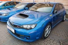 Blue Pre-facelift Subaru Impreza WRX STI car. Saint-Petersburg, Russia - April 11, 2015: Blue Pre-facelift Subaru Impreza WRX STI car stands parked on the city Stock Photo