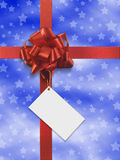 Blue present. Red ribbon over blue paper with white stars Stock Image