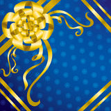 Blue present background with gold bow Stock Images