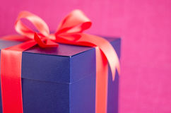 Blue present box with red ribbon isolated Stock Images