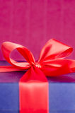 Blue present box with red ribbon isolated Royalty Free Stock Photos