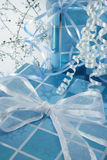 Blue presents vertical. Presents wrapped with blue starred paper and white bow Royalty Free Stock Image