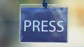 Blue press card, journalist authorization pass, mass media privilege, event. Stock footage stock footage