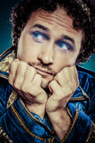 Blue prince dressed with elegant prussian blue jacket, melanchol Stock Photography