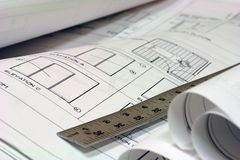 Blue Print Building Plans with Ruler. Close up of blue prints with metal ruler Stock Photography