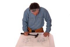 Blue prints 4. Carpenter reading blueprints isolated on white Stock Photos
