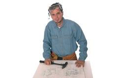 Blue prints 5. Carpenter reading blueprints isolated on white Stock Images
