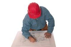 Blue prints 6. Carpenter reading blueprints isolated on white Royalty Free Stock Photo