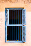 Blue Prison Bars And Wooden Louvred Shutters Royalty Free Stock Image