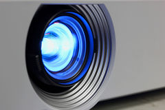 Blue projector. Blue a projector on lens closeup stock image