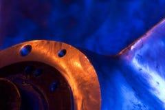 Blue propeller. Detail of a propeller illuminated by blue light Stock Photo