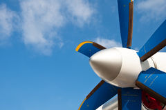 Blue propeller of white airplane Royalty Free Stock Photography