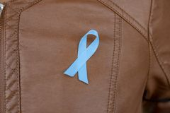 Blue prostate cancer awareness ribbon stock photography
