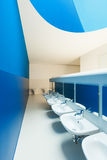 Blue public bathroom Royalty Free Stock Photo