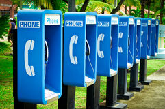 Blue public phone Stock Photos