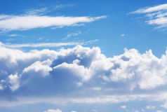 Blue puffy cloud sky. And clouds Stock Photography