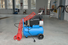 Blue pump compressor for washing cars, indoor. Cleaning concept. Stock Photo
