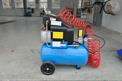 Blue pump compressor for washing cars, indoor. Cleaning concept. Royalty Free Stock Image