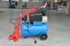 Blue pump compressor for washing cars, indoor. Cleaning concept. Royalty Free Stock Photography