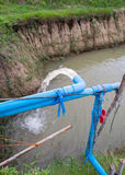 Blue pump pipe water flow down Royalty Free Stock Photography