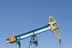 Pumpjack on blue sky Royalty Free Stock Photos