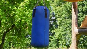 Blue punching bag at outdoor stock footage