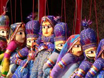Blue puppet magic. Detail of hand carved puppets awaiting their owners Stock Photography