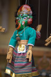 Blue puppet on a string in Kathmandu Royalty Free Stock Photos