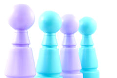 Blue and purple colored bowling pins Royalty Free Stock Images