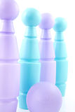 Blue and purple colored bowling pins Royalty Free Stock Photo