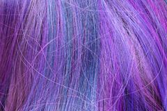 Blue and purple colored hair strands stock photo