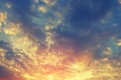 Beautiful colorful sunset sky background with the light of sun behind. stock photography
