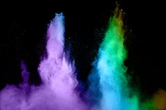 Blue and purple dust particles explosion on black background. royalty free stock photo