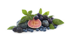 Blue and purple food. Group of fresh fruits and berries royalty free stock photos