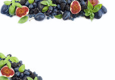 Blue and purple food. Ripe blueberries, blackberries, grapes, plums and figs. stock image