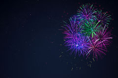 Blue purple green celebration firework copy space. Stock Images