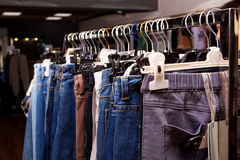 Blue and purple jeans in a shop Stock Photo