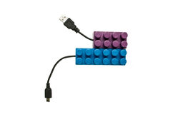 Blue and purple legos connected to usb cables Royalty Free Stock Photos