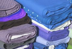 Blue and purple precious Italian manufacture fabrics for sale in Royalty Free Stock Image