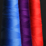 Blue purple and scarlet thread Royalty Free Stock Photos