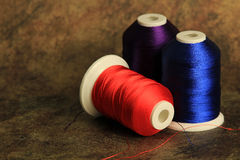 Blue purple and scarlet thread Stock Photo