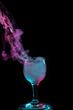 Blue and purple smoke in the glass. Halloween. Stock Photo